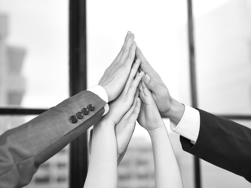 Business people bringing hands together